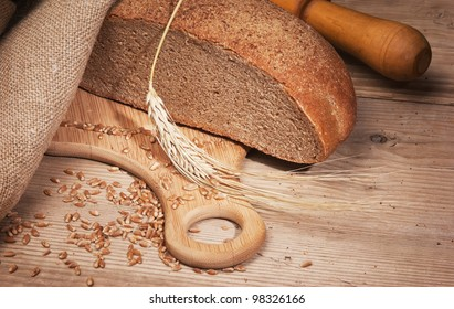 rye bread, and corn on the wooden table