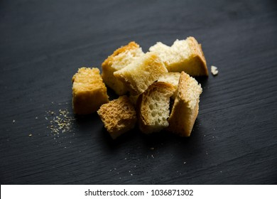 Rye Bread croutons on black wooden background