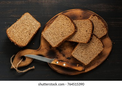Rye bread is cut into pieces on a cutting board