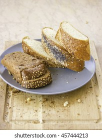 rye bread with prunes and long loaf with sesame and poppy seeds