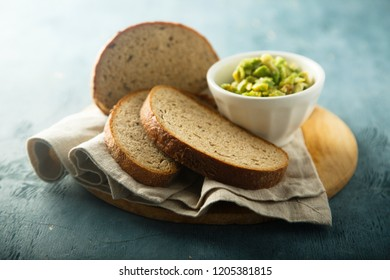 Rye bread served with avocado dip