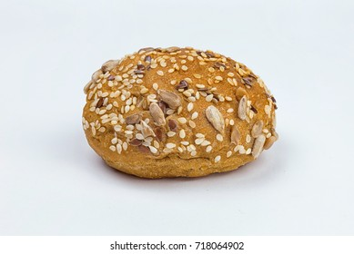 Rye bun seeded on a white background, macro