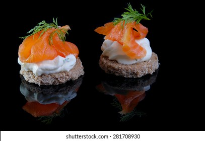 rye canapes with cream cheese and smoked salmon, a typical part of a buffet in Denmark