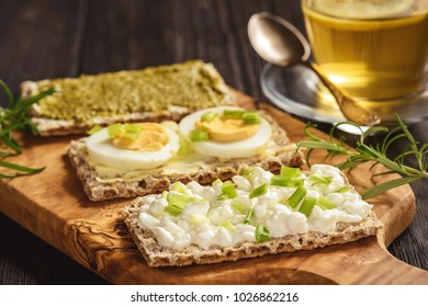Rye crisp bread sandwiches with eggs, pesto and cottage cheese.