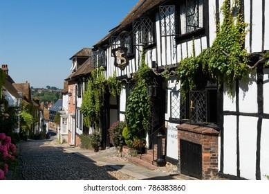 RYE, EAST SUSSEX, ENGLAND - AUGUST 05, 2017: The medieval Mermaid Inn built in 1420 along Mermaid Street