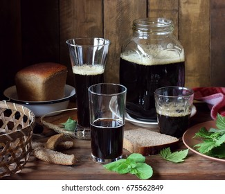 Rye kvass made at home. A pitcher with a dark drink on the table.