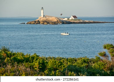 Rye, NH, USA - August 9, 2014: Early morning fishermen try their luck in the strait between Star Island and White Island on a clear summer day.