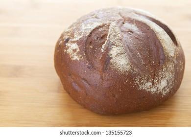 Rye round freshly baked bread at bakery.