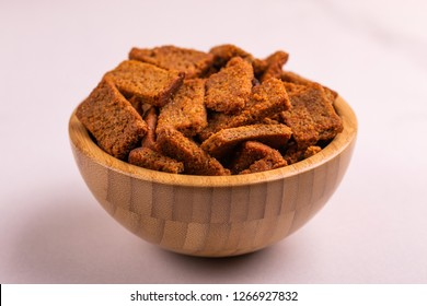 Rye salted crackers in wooden bowl on light marble background. Beer appetizer. Cinema snack. Copy space. Horizontal view