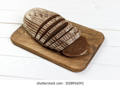Rye sliced bread on the white table.