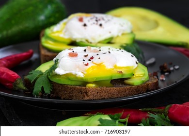 Rye toasts with sliced avocado and poached eggs