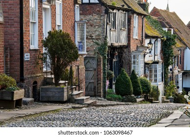 RYE, UK - APRIL 5th, 2018: Mermaid Street in  Rye is an old cobbled street which used to be the ancient town's main road. This famous street is lined with medival buidlings including Mermaid Inn