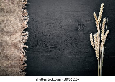 Rye, wheat Wooden on black background. Top view.
