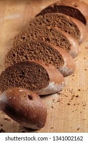 Rye wholegrain bread loaf cut in pieces