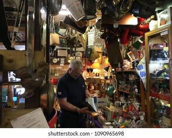 Rye,England,24 July 2016; a man inside antique vintage shop market in Rye United Kingdom