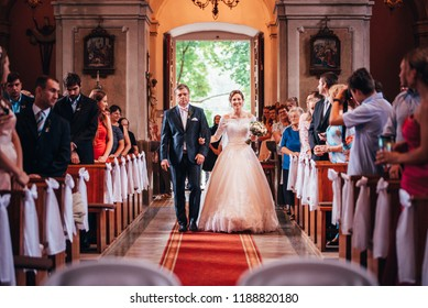 RYKYNCICE, SLOVAKIA - SEPTEMBER 1, 2018: Beautiful bride walks into the church with her dad