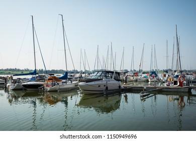 RYN, WARMIA-MASURIA PROVINCE / POLAND - JULY 31, 2018: Marina and pier on Rynskie lake, town of Ryn.