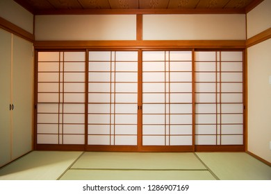 Ryokan, traditional Japanese room with closed slide doors during daylight.