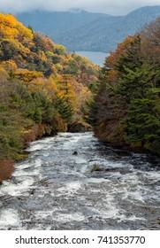 Ryuzu fall and lake Chuzenji behind at Nikko in autumn season.