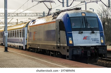 """RZEPIN, POLAND - MARCH 29, 2014: PKP Intercity Express """"Warsaw-Berlin"""", ready for departure.The driver waits for signal."""
