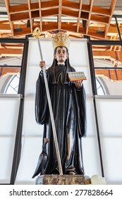 S. Bento da Porta Aberta, Portugal. April 06, 2015: St Benedict statue used for worship by pilgrims in the Crypt. Pope Francis raised the sanctuary to Basilica in the 400th anniversary, March 21st