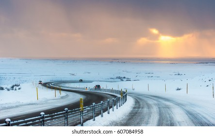 S curved long road Iceland, driving in winter condition