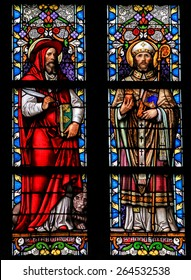 'S HERTOGENBOSCH, THE NETHERLANDS - JULY 23, 2011: Stained Glass Window depicting Saint Hieronymus and Saint Augustinus in Den Bosch Cathedral, North Brabant.