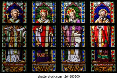 'S HERTOGENBOSCH, THE NETHERLANDS - JULY 23, 2011: Stained Glass Window depicting Saint Basil of Caesarea, Gregory of Nazianzus, John Chrysostom and Athanasius of Alexandria in Den Bosch Cathedral.
