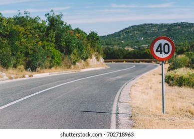 S shaped curve road and 40 km/h road sign, Zaton, Sibenik, Croatia