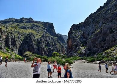 Sa Calobra, Mallorca, Spain - August 30, 2018: Rest in tourists in Sa Calobra