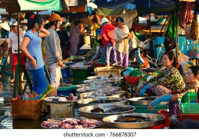 Sa Dec, Vietnam - 2012: Group of Vietnamese women purchase fish at outdoor market