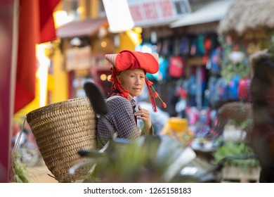 Sa Pa, Lao Cai, Vietnam - 11/26/2018:  Street vendor of the Red Dao ethnic group selling their handmade embroidery in the streets of Sa Pa