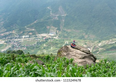Sa Pa town, Lao Cai Province, Vietnam - May 12, 2018: The woman is relaxing and enjoys life on the top of the mountain in Sa Pa town, Lao Cai province, Vietnam