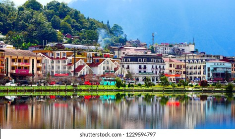Sa Pa, Vietnam - October 26, 2018: View of Sa Pa Lake and town with reflections in the water