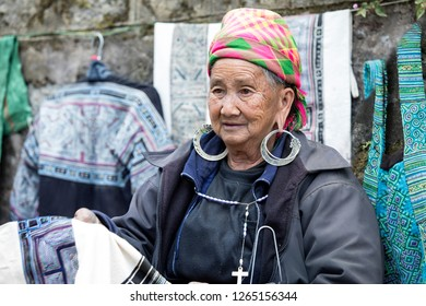Sa Pa,Lao Cai, Vietnam - 11/25/2018:  Woman from the Hmong ethnic group selling their embroidery on the streets of Sa Pa.
