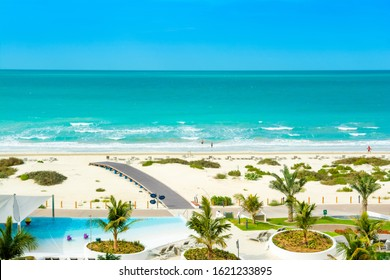 Saadiyat island, UAE - 11 January 2020: Beautiful landscape of clear turquoise ocean and sandy beach in Saadiyat island, United Arab Emirates
