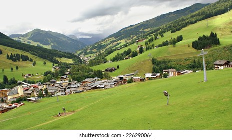 SAALBACH,HINTERGLEMM, AUSTRIA - JULY 14, 2014. Rainy weather in summer, in the village  - Austrian  Alps Mountains area, seen from lift cable.