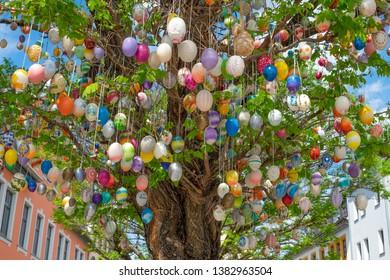 Saalfeld, Thuringia, Germany-27.04.2019: The old city town of Saalfeld, famous easter colorful plastic eggs tree
