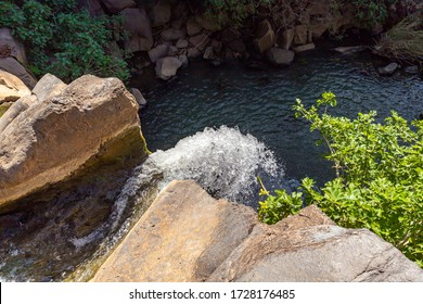 The Saar mountain river with cold and crystal clear water flows in a crevice in the mountains of the Golan Heights in Israel.