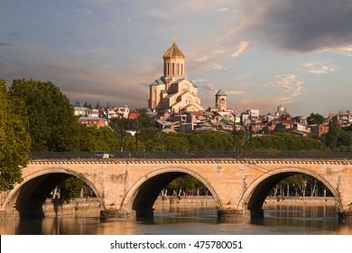 Saarbrucken bridge and Sameba Cathedral in Tbilisi, Georgia