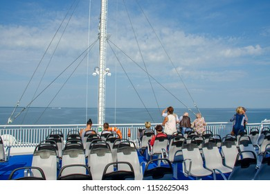 SAAREMAA, ESTONIA, July 14, 2018:  People on the ferry deck departing from continent to Saaremaa
