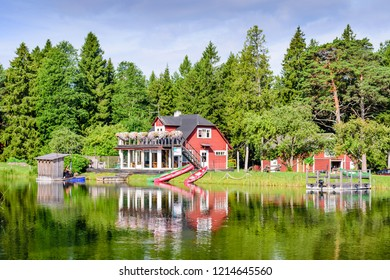 Saaremaa island, Estonia - July 13, 2018: picturesque lake with camping and forest on the shore
