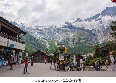 saas fee, valais, switzerland, august 22, 2018, railway station in saas fee with the beautiful mountain panorama.