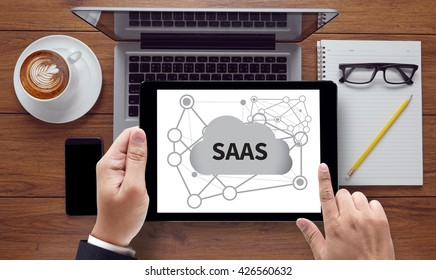 SAAS, on the tablet pc screen held by businessman hands - online, top view