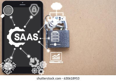 SAAS (Software As A Service) Business Development Concept. Tablet Computer with cogwheel SaaS icon on virtual screen on background of network IT icons.