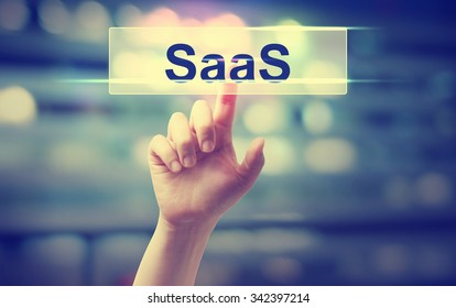 SaaS - Software as a Service concept with hand pressing a button on blurred abstract background