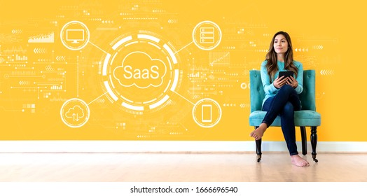 SaaS - software as a service concept with young woman holding a tablet computer