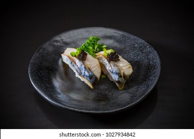 Saba Bouzushi Nigiri, Sushi Saba on traditional Japanese food on black dish, Japanese food style, Japanese menu, sushi saba, Saba sushi on black background, selective focus