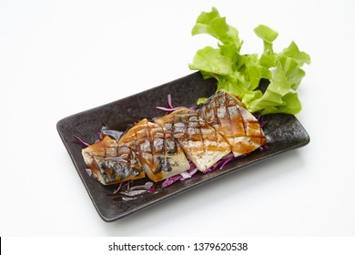 Saba fish grilled with sauce or Saba kabayaki on white background, Japanese style food.