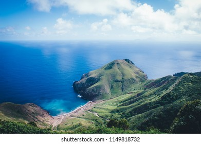 Saba Island - Beach landscape with transparent blue water and tropical forest